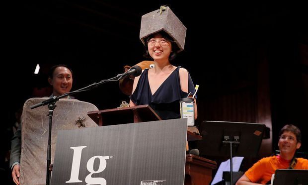 Patricia Yang accepts the 2019 Ig Nobel Prize in Physics at the 29th First Annual Ig Nobel Prize Ceremony in Cambridge