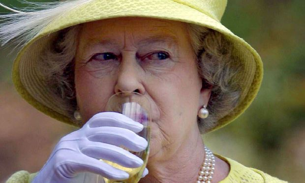 Britain´s Queen Elizabeth II takes a sip of wine with during a wine country tour in Barossa Valley n..