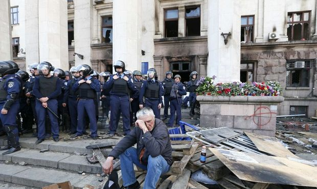 A man reacts outside trade union building, where deadly fire occurred, in Odessa