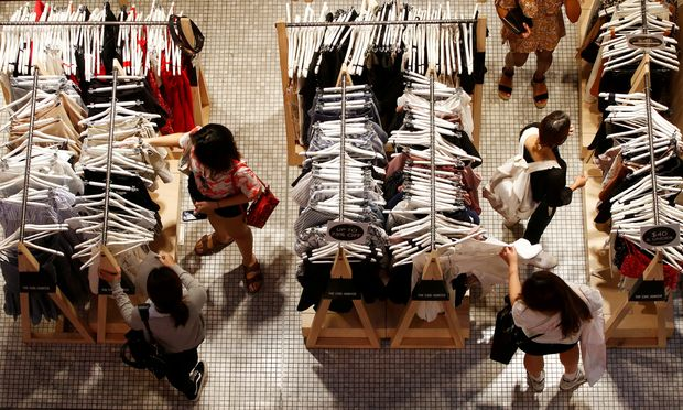FILE PHOTO: Women shop for clothes on a store in a shopping mall in Sydney