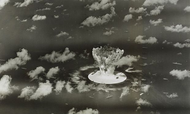 File handout picture of a mushroom cloud rising with ships below during Operation Crossroads nuclear weapons test on Bikini Atoll, Marshall Islands