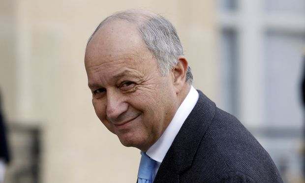French Foreign Affairs Minister Laurent Fabius arrives at the Elysee Palace in Paris