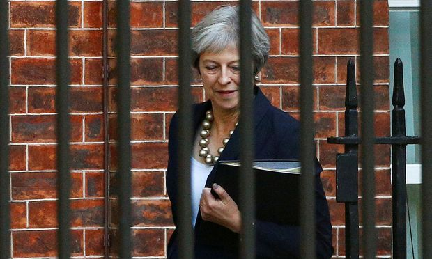 FILE PHOTO: Britain´s Prime Minister Theresa May arrives at Downing Street in London
