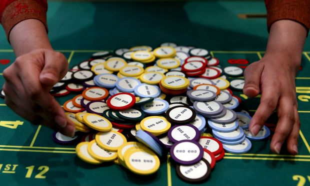 A casino collects chips at a roulette table in Pasay city, Metro Manila