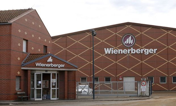 Logos of Wienerberger, the world's biggest brickmaker, are pictured at its headquarters in Hennersdorf