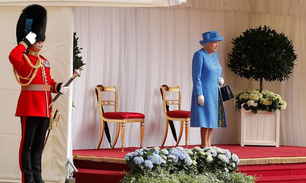 Britain's Queen Elizabeth waits for U.S. President Donald Trump and the First Lady Melania Trump to arrive for tea at Windsor Castle in Windsor