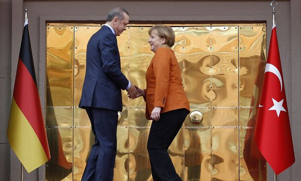 Turkey´s Prime Minister Erdogan and German Chancellor Merkel shake hands during a welcoming ceremony in Ankara