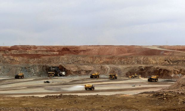Mining trucks are seen at the Oyu Tolgoi mine in Mongolia's South Gobi region