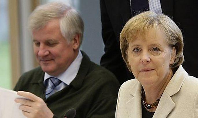 CSU head Seehofer and German Chancellor Merkel