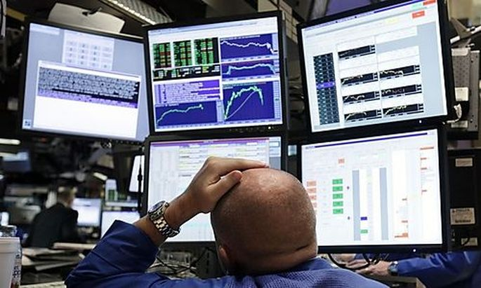 A specialist works at his post on the floor of the New York Stock Exchange after the Fed interest rat