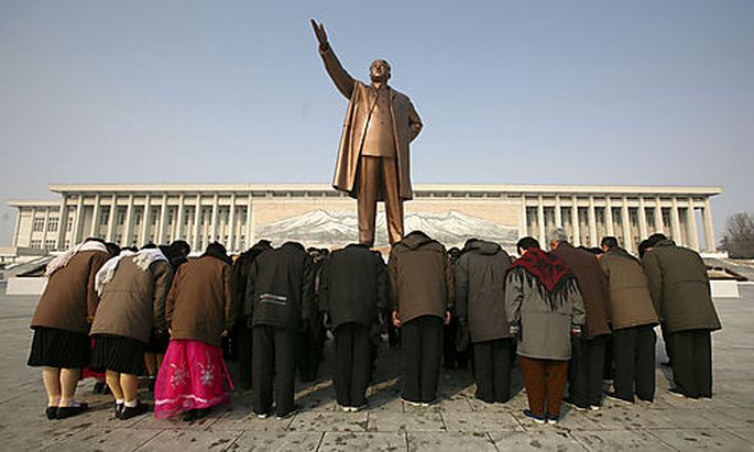 People bow in front of a statue of Kim Il Sung in Pyongyang, North Korea Tuesday Feb 26 2008 AP