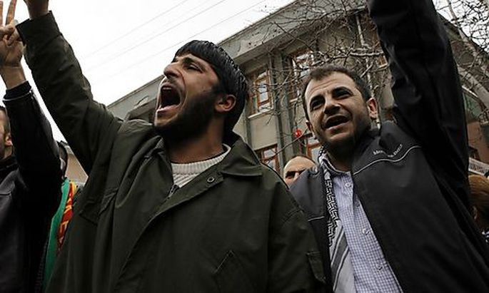 Supporters of the pro-Kurdish Democratic Society Party (DTP) shout slogans in front of the DTP headqu