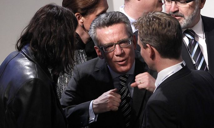 German Interior Minister Maiziere talks to Malmstroem, European Union Commissioner for Home Affairs during opening of 50th Conference on Security Policy in Munich