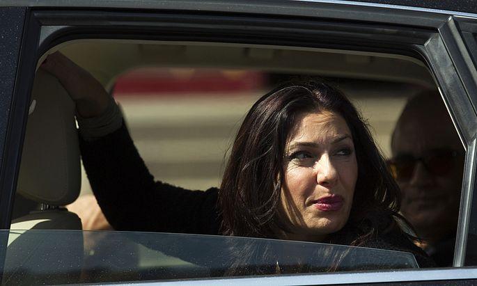 Likud legislator Regev looks out a car window in Netanya