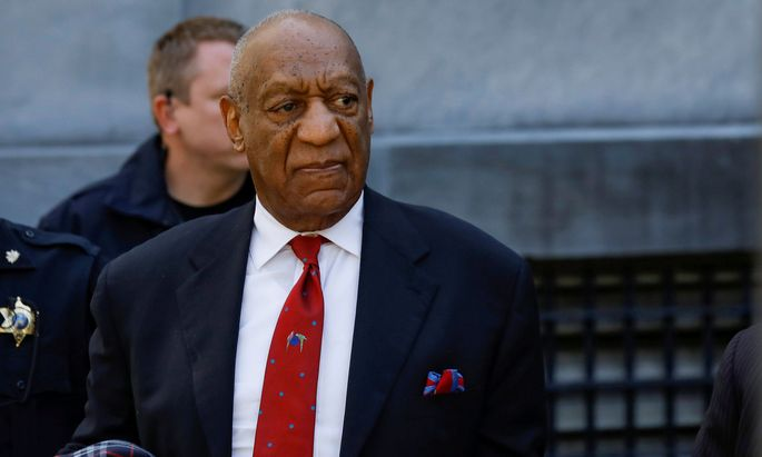 FILE PHOTO: Actor and comedian Bill Cosby exits the Montgomery County Courthouse after a jury convicted him in a sexual assault retrial in Norristown, Pennsylvania
