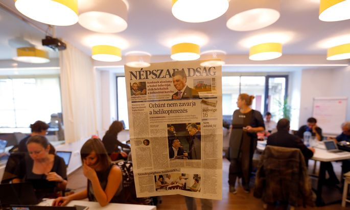 A copy of the last issue of the leftist newspaper Nepszabadsag, which was unexpectedly shut down on Saturday amid cries of a crackdown by right-wing Prime Minister Viktor Orban´s government, hangs on the wall of a temporary newsroom in Budapest
