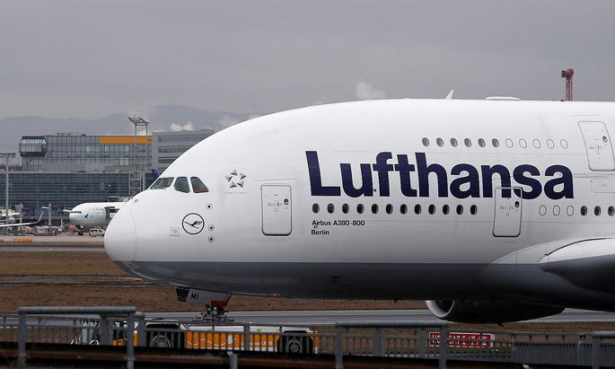 FILE PHOTO: An Airbus A380 of German air carrier Lufthansa is pulled for technical maintainance at the airport in Frankfur