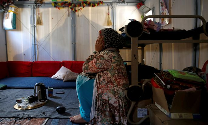 Syrian refugee Walaa sits inside her family´s tent at the Souda municipality-run camp on the island of Chios
