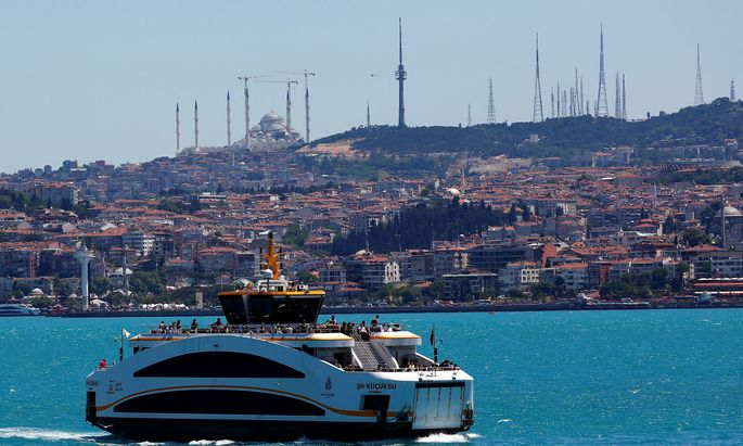 People travel on a ferry over the Bosphorus in Istanbul