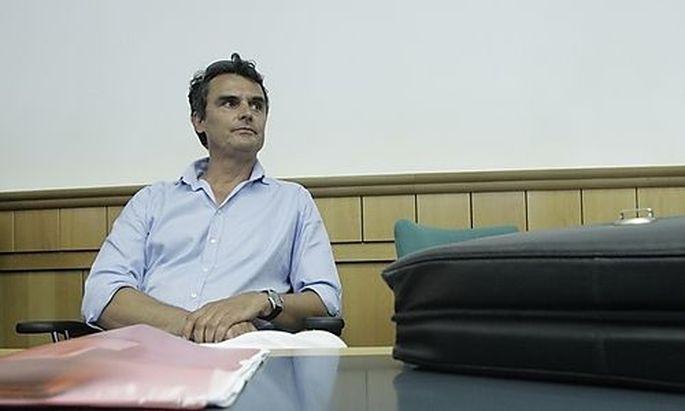 Former Austrian finance ministry employee Ramprecht sits in a courtroom in Vienna