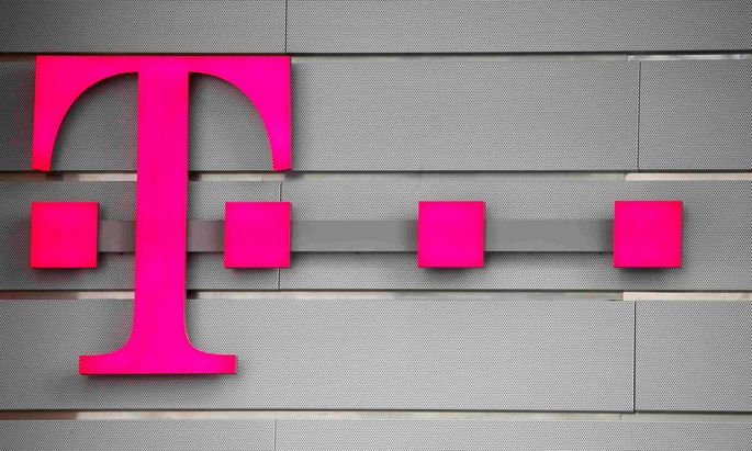FILE PHOTO: A logo of Germany's telecommunications giant Deutsche Telekom AG is seen before the company's annual news conference in Bonn