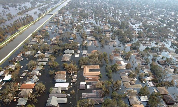 File photo of Louisiana homes near a levee remain under water a week after Hurricane Katrina