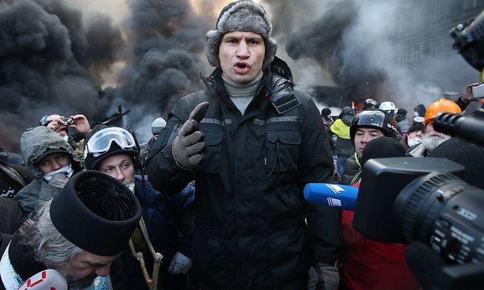 ITAR TASS KIEV UKRAINE JANUARY 23 2014 Udar party leader Vitali Klitschko L is among oppositi