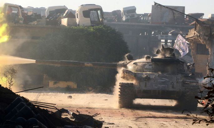 A Free Syrian Army tank fires in Ramousah area southwest of Aleppo