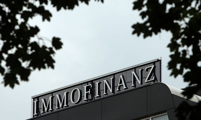 FILE PHOTO: The logo of Austrian real estate group Immofinanz is pictured on top of the company´s headquarters building in Vienna