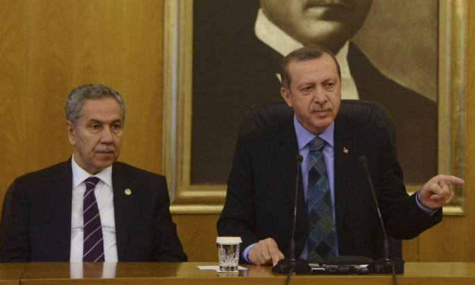 Turkey's Prime Minister Erdogan speaks during a news conference at Ataturk International Airport in Istanbul