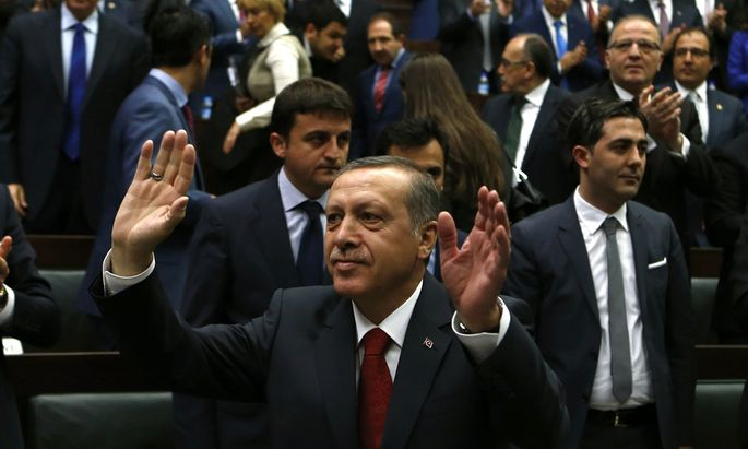 Turkey´s PM Erdogan greets members of the parliament from his ruling AK Party during a meeting in Ankara