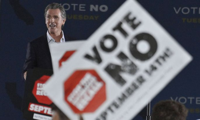 California Gov. Gavin Newsom addresses supporters urging voters to vote no in Tuesday s recall election, saying, Tomorr