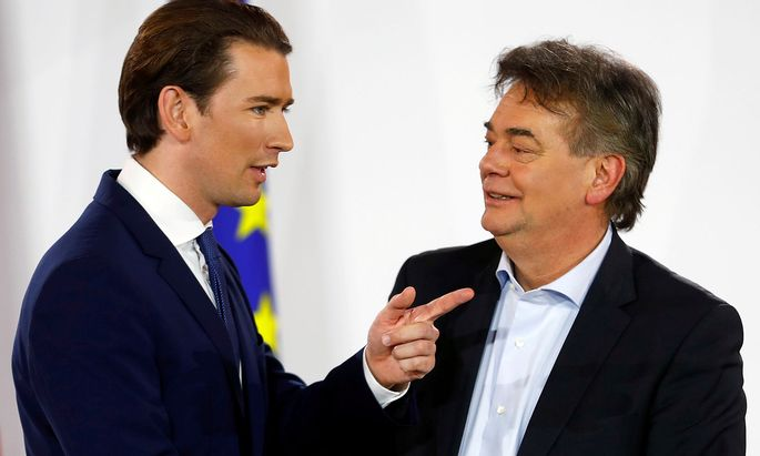 FILE PHOTO: Head of Austria's Green Party Werner Kogler and head of People's Party (OeVP) Sebastian Kurz talk after delivering a statement in Vienna
