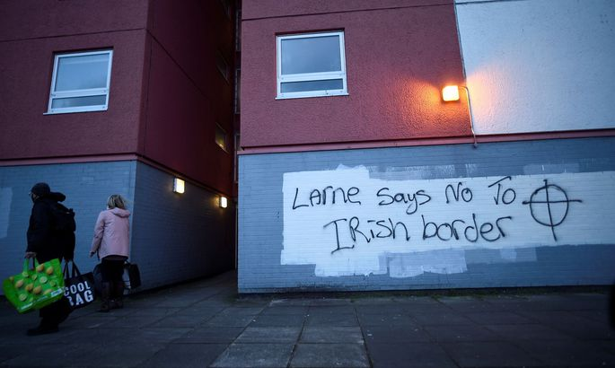Graffiti against the Brexit border checks in relation to the Northern Ireland protocol at the harbour in Larne