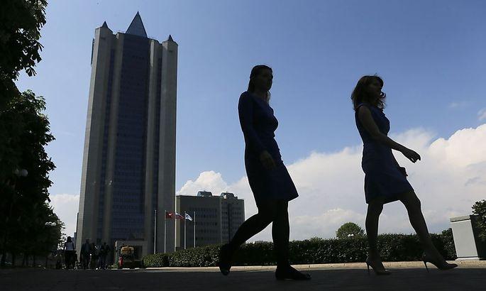 Women walk near Gazprom's main office in Moscow