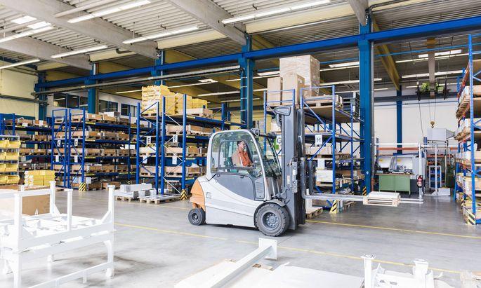Man on forklift in factory warehouse model released Symbolfoto property released PUBLICATIONxINxGERx