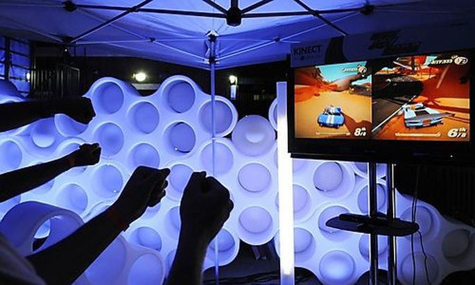 Guests try out X-box Kinect games during preview for E3 in Los Angeles
