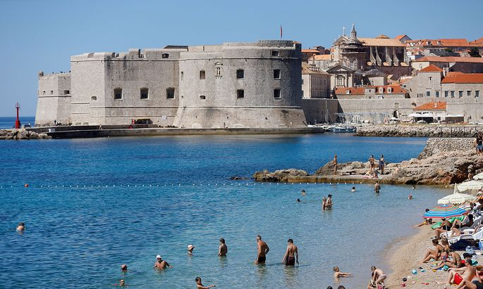 FILE PHOTO: People are seen at Banje beach in Dubrovnik