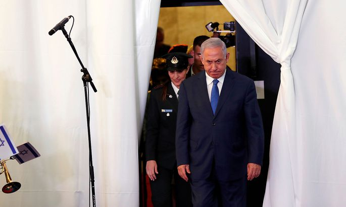 FILE PHOTO: Israeli PM Netanyahu looks on as he arrives to review an honor guard with his Ethiopian counterpart Abiy Ahmed during their meeting in Jerusalem