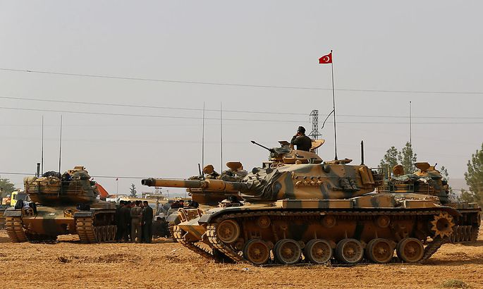 Turkish army tanks and military personnel are stationed in Karkamis on the Turkish-Syrian border in the southeastern Gaziantep province