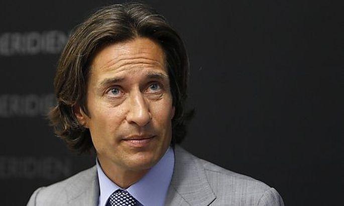 Former Austrian Finance Minister Grasser listens during news conference in Vienna