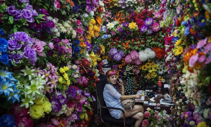 Chinesische Plastikblumen könnten in den USA bald teurer werden. Außer es gibt zuvor den von Trump gewünschten Deal.