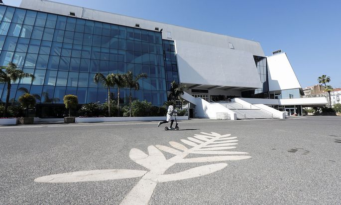 A man skates past a Palme d´Or symbol on the pavement near the Festival palace on the Croisette in Cannes where the Cannes Film Festival and the Cannes Lions take place, as a lockdown is imposed to slow the rate of the coronavirus disease (COVID-19)