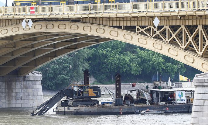 A dredge is seen digging near the site of a tourist boat accident in the Danube river in Budapest