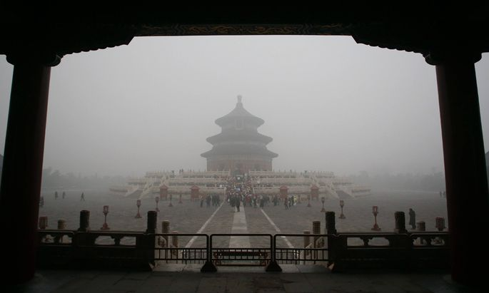 BEIJING CHINA DECEMBER 01 CHINA OUT Visitors play in Temple of Heaven even with heavy smog on
