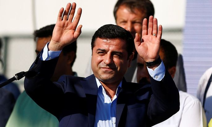 Selahattin Demirtas, co-leader of the pro-Kurdish Peoples' Democratic Party (HDP), greets the crowd during a peace rally to protest against Turkish military operations in northern Syria, in Istanbul