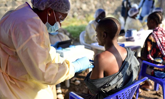 A Congolese health worker administers an ebola vaccine to a man at the Himbi Health Centre in Goma