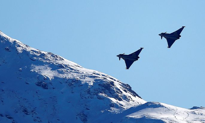 FILE PHOTO: Two Eurofighter Typhoon aircrafts fly over the Streif course during an aerial exhibition before the start of the men's Alpine Skiing World Cup Super G race in Kitzbuehel
