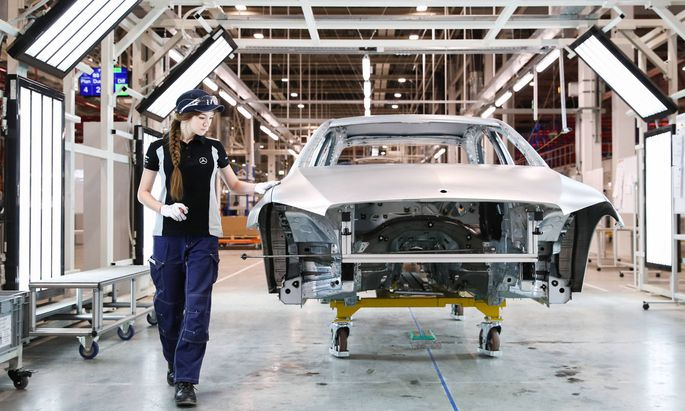 MOSCOW REGION RUSSIA APRIL 3 2019 A worker in an assembly room of a Mercedes Benz plant of the