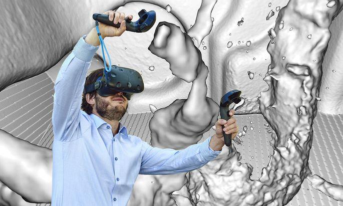 Aardworx-Mitgründer Harald Steinlechner navigiert sich mit VR-Brille durch ein Alu-Getriebegehäuse.